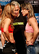 BRISBANE, AUSTRALIA - DECEMBER 06:  (L-R) Opponents Julie Kedzie and Bethe Correia face off during the UFC Fight Night weigh-in at the Brisbane Entertainment Centre on December 6, 2013 in Brisbane, Australia. (Photo by Josh Hedges/Zuffa LLC/Zuffa LLC via Getty Images)