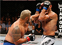 BRISBANE, AUSTRALIA - DECEMBER 07:  (L-R) Mark Hunt punches Antonio