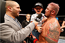 BRISBANE, AUSTRALIA - DECEMBER 07:  Mark Hunt (R) is interviewed by Jon Anik with his son after his five-round heavyweight fight against Antonio