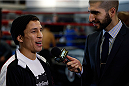 SACRAMENTO, CA - DECEMBER 11:  Joseph Benavidez interacts with media before an open training session at Ultimate Fitness on December 11, 2013 in Sacramento, California. (Photo by Josh Hedges/Zuffa LLC/Zuffa LLC via Getty Images)