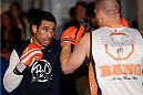 SACRAMENTO, CA - DECEMBER 11:  (L-R) Danny Castillo works out with head coach Duane Ludwig during an open training session for media at Ultimate Fitness on December 11, 2013 in Sacramento, California. (Photo by Josh Hedges/Zuffa LLC/Zuffa LLC via Getty Images)