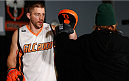 SACRAMENTO, CA - DECEMBER 11:  (L-R) Head coach Duane Ludwig holds pads for Urijah Faber during an open training session for media at Ultimate Fitness on December 11, 2013 in Sacramento, California. (Photo by Josh Hedges/Zuffa LLC/Zuffa LLC via Getty Images)