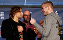 SACRAMENTO, CA - DECEMBER 12:  (L-R) Opponents Urijah Faber and Michael McDonald face off during the final pre-fight press conference before the UFC on FOX event at Sleep Train Arena on December 12, 2013 in Sacramento, California. (Photo by Josh Hedges/Zuffa LLC/Zuffa LLC via Getty Images)