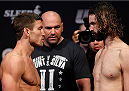 SACRAMENTO, CA - DECEMBER 13:  (L-R) Opponents Sam Stout and Cody McKenzie face off during the UFC on FOX weigh-in at Sleep Train Arena on December 13, 2013 in Sacramento, California. (Photo by Josh Hedges/Zuffa LLC/Zuffa LLC via Getty Images)