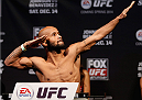 SACRAMENTO, CA - DECEMBER 13:  Demetrious Johnson weighs in during the UFC on FOX weigh-in at Sleep Train Arena on December 13, 2013 in Sacramento, California. (Photo by Josh Hedges/Zuffa LLC/Zuffa LLC via Getty Images)