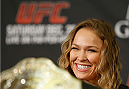 LAS VEGAS, NV - DECEMBER 26:  Ronda Rousey interacts with media during the UFC 168 pre-fight press conference at the MGM Grand Hotel/Casino on December 26, 2013 in Las Vegas, Nevada. (Photo by Josh Hedges/Zuffa LLC/Zuffa LLC via Getty Images)