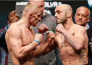 LAS VEGAS, NV - DECEMBER 27:  (L-R) Opponents Dennis Siver and Manny Gamburyan face off during the UFC 168 weigh-in at the MGM Grand Garden Arena on December 27, 2013 in Las Vegas, Nevada. (Photo by Josh Hedges/Zuffa LLC/Zuffa LLC via Getty Images)