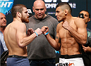 LAS VEGAS, NV - DECEMBER 27:  (L-R) Opponents Jim Miller and Fabricio Camoes face off during the UFC 168 weigh-in at the MGM Grand Garden Arena on December 27, 2013 in Las Vegas, Nevada. (Photo by Josh Hedges/Zuffa LLC/Zuffa LLC via Getty Images)