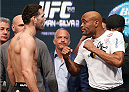 LAS VEGAS, NV - DECEMBER 27:  (L-R) Opponents Chris Weidman and Anderson Silva face off during the UFC 168 weigh-in at the MGM Grand Garden Arena on December 27, 2013 in Las Vegas, Nevada. (Photo by Josh Hedges/Zuffa LLC/Zuffa LLC via Getty Images)