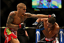 LAS VEGAS, NV - DECEMBER 28:  (L-R) Dustin Poirier punches Diego Brandao in their featherweight bout during the UFC 168 event at the MGM Grand Garden Arena on December 28, 2013 in Las Vegas, Nevada. (Photo by Josh Hedges/Zuffa LLC/Zuffa LLC via Getty Images) *** Local Caption *** Dustin Poirier; Diego Brandao