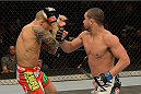 LAS VEGAS, NV - DECEMBER 28:  (R-L) Diego Brandao punches Dustin Poirier in their featherweight bout during the UFC 168 event at the MGM Grand Garden Arena on December 28, 2013 in Las Vegas, Nevada. (Photo by Donald Miralle/Zuffa LLC/Zuffa LLC via Getty Images) *** Local Caption *** Dustin Poirier; Diego Brandao