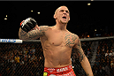 LAS VEGAS, NV - DECEMBER 28:  Dustin Poirier reacts to his victory over Diego Brandao in their featherweight bout during the UFC 168 event at the MGM Grand Garden Arena on December 28, 2013 in Las Vegas, Nevada. (Photo by Donald Miralle/Zuffa LLC/Zuffa LLC via Getty Images) *** Local Caption *** Dustin Poirier