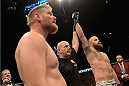 LAS VEGAS, NV - DECEMBER 28:  Travis Browne (right) reacts to his victory over Josh Barnett in their heavyweight bout during the UFC 168 event at the MGM Grand Garden Arena on December 28, 2013 in Las Vegas, Nevada. (Photo by Donald Miralle/Zuffa LLC/Zuffa LLC via Getty Images) *** Local Caption *** Travis Browne