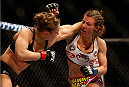 LAS VEGAS, NV - DECEMBER 28:  (L-R) Ronda Rousey punches Miesha Tate in their UFC women's bantamweight championship bout during the UFC 168 event at the MGM Grand Garden Arena on December 28, 2013 in Las Vegas, Nevada. (Photo by Josh Hedges/Zuffa LLC/Zuffa LLC via Getty Images) *** Local Caption *** Ronda Rousey; Miesha Tate