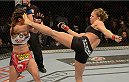 LAS VEGAS, NV - DECEMBER 28:  (R-L) Ronda Rousey kicks Miesha Tate in their UFC women's bantamweight championship bout during the UFC 168 event at the MGM Grand Garden Arena on December 28, 2013 in Las Vegas, Nevada. (Photo by Donald Miralle/Zuffa LLC/Zuffa LLC via Getty Images) *** Local Caption *** Ronda Rousey; Miesha Tate