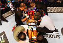 SINGAPORE - JANUARY 04:  Kiichi Kunimoto is carried out of the cage on a stretcher after illegal elbows to the back of the head from his opponent, Luiz Dutra, in their welterweight bout during the UFC Fight Night event at the Marina Bay Sands Resort on January 4, 2014 in Singapore. (Photo by Mitch Viquez/Zuffa LLC/Zuffa LLC via Getty Images)