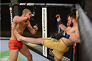 LACHUTE, CANADA - NOVEMBER 2:  Team Australia fighter Brendan O'Reilly (R) kicks Team Canada fighter Kajan Johnson (L) in their welterweight bout during filming of The Ultimate Fighter Nations television series on November 2, 2013 in Lachute, Quebec, Canada. (Photo by Richard Wolowicz/Zuffa LLC/Zuffa LLC via Getty Images) *** Local Caption *** Brendan O'Reilly; Kajan Johnson