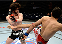 DULUTH, GA - JANUARY 15:  (R-L) Beneil Dariush kicks Charlie Brenneman in their welterweight fight during the UFC Fight Night event inside The Arena at Gwinnett Center on January 15, 2014 in Duluth, Georgia. (Photo by Jeff Bottari/Zuffa LLC/Zuffa LLC via Getty Images)