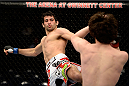 DULUTH, GA - JANUARY 15:  (L-R) Beneil Dariush kicks Charlie Brenneman in their welterweight fight during the UFC Fight Night event inside The Arena at Gwinnett Center on January 15, 2014 in Duluth, Georgia. (Photo by Jeff Bottari/Zuffa LLC/Zuffa LLC via Getty Images)