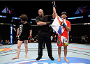 DULUTH, GA - JANUARY 15: (R-L) Beneil Dariush reacts after submitting Charlie Brenneman in their welterweight fight during the UFC Fight Night event inside The Arena at Gwinnett Center on January 15, 2014 in Duluth, Georgia. (Photo by Jeff Bottari/Zuffa LLC/Zuffa LLC via Getty Images)