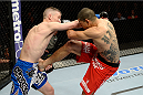 DULUTH, GA - JANUARY 15:  (L-R) Garett Whiteley fights Vinc Pichel in their lightweight fight during the UFC Fight Night event inside The Arena at Gwinnett Center on January 15, 2014 in Duluth, Georgia. (Photo by Jeff Bottari/Zuffa LLC/Zuffa LLC via Getty Images)