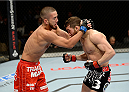 DULUTH, GA - JANUARY 15: (L-R) Louis Smolka prepares to knee Alpetkin Ozkilic in their featherweight fight during the UFC Fight Night event inside The Arena at Gwinnett Center on January 15, 2014 in Duluth, Georgia. (Photo by Jeff Bottari/Zuffa LLC/Zuffa LLC via Getty Images)