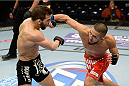 DULUTH, GA - JANUARY 15: (R-L) Louis Smolka lands a punch against Alpetkin Ozkilic in their featherweight fight during the UFC Fight Night event inside The Arena at Gwinnett Center on January 15, 2014 in Duluth, Georgia. (Photo by Jeff Bottari/Zuffa LLC/Zuffa LLC via Getty Images)