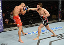 DULUTH, GA - JANUARY 15: (R-L) Alpetkin Ozkilic lands a punch to Louis Smolka in their featherweight fight during the UFC Fight Night event inside The Arena at Gwinnett Center on January 15, 2014 in Duluth, Georgia. (Photo by Jeff Bottari/Zuffa LLC/Zuffa LLC via Getty Images)