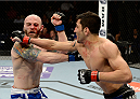 DULUTH, GA - JANUARY 15:  (R-L) Ramsey Nijem punches Justin Edwards in their lightweight fight during the UFC Fight Night event inside The Arena at Gwinnett Center on January 15, 2014 in Duluth, Georgia.  (Photo by Jeff Bottari/Zuffa LLC/Zuffa LLC via Getty Images)