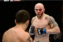 DULUTH, GA - JANUARY 15: (R-L) A bloodied Justin Edwards fights Ramsey Nijem in their lightweight fight during the UFC Fight Night event inside The Arena at Gwinnett Center on January 15, 2014 in Duluth, Georgia. (Photo by Jeff Bottari/Zuffa LLC/Zuffa LLC via Getty Images)