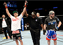 DULUTH, GA - JANUARY 15: (L-R) Ramsey Nijem reacts after winning in a decision over Justin Edwards in their lightweight fight during the UFC Fight Night event inside The Arena at Gwinnett Center on January 15, 2014 in Duluth, Georgia. (Photo by Jeff Bottari/Zuffa LLC/Zuffa LLC via Getty Images)