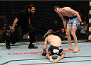 DULUTH, GA - JANUARY 15: (R-L) Cole Miller reacts after Sam Sicilia taps out in their featherweight fight during the UFC Fight Night event inside The Arena at Gwinnett Center on January 15, 2014 in Duluth, Georgia. (Photo by Jeff Bottari/Zuffa LLC/Zuffa LLC via Getty Images)