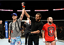 DULUTH, GA - JANUARY 15:  (L-R) Cole Miller celebrates after his victory by submission over Sam Sicilia in their featherweight fight during the UFC Fight Night event inside The Arena at Gwinnett Center on January 15, 2014 in Duluth, Georgia. (Photo by Jeff Bottari/Zuffa LLC/Zuffa LLC via Getty Images)