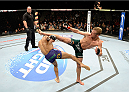 DULUTH, GA - JANUARY 15: (R-L) TJ Dillashaw kicks Mike Easton in their bantamweight fight during the UFC Fight Night event inside The Arena at Gwinnett Center on January 15, 2014 in Duluth, Georgia. (Photo by Jeff Bottari/Zuffa LLC/Zuffa LLC via Getty Images)