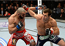 DULUTH, GA - JANUARY 15:  (R-L) Luke Rockhold punches Costas Philippou in their middleweight fight during the UFC Fight Night event inside The Arena at Gwinnett Center on January 15, 2014 in Duluth, Georgia.  (Photo by Jeff Bottari/Zuffa LLC/Zuffa LLC via Getty Images)