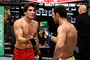 LACHUTE, CANADA - NOVEMBER 5:  (L-R) Team Canada fighter Elias Theodorou is congratulated by Team Australia fighter Zein Saliba after Elias defeated Zein by decision during filming of The Ultimate Fighter Nations television series on November 5, 2013 in Lachute, Quebec, Canada. (Photo by Richard Wolowicz/Zuffa LLC/Zuffa LLC via Getty Images) *** Local Caption *** Elias Theodorou; Zein Saliba