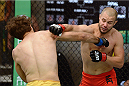 LACHUTE, CANADA - NOVEMBER 8:  (R-L) Team Canada fighter Chad Leprise punches Team Australia fighter Chris Indich in their welterweight bout during filming of The Ultimate Fighter Nations television series on November 8, 2013 in Lachute, Quebec, Canada. (Photo by Richard Wolowicz/Zuffa LLC/Zuffa LLC via Getty Images) *** Local Caption *** Chris Indich; Chad Leprise