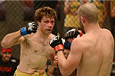 LACHUTE, CANADA - NOVEMBER 8:  (L-R) Team Australia fighter Chris Indich punches Team Canada fighter Chad Leprise in their welterweight bout during filming of The Ultimate Fighter Nations television series on November 8, 2013 in Lachute, Quebec, Canada. (Photo by Richard Wolowicz/Zuffa LLC/Zuffa LLC via Getty Images) *** Local Caption *** Chris Indich; Chad Leprise