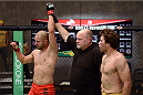 LACHUTE, CANADA - NOVEMBER 8:  Team Canada fighter Chad Leprise is announced the winner after defeating Team Australia fighter Chris Indich in their welterweight bout during filming of The Ultimate Fighter Nations television series on November 8, 2013 in Lachute, Quebec, Canada. (Photo by Richard Wolowicz/Zuffa LLC/Zuffa LLC via Getty Images) *** Local Caption *** Chris Indich; Chad Leprise