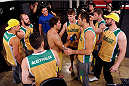 LACHUTE, CANADA - NOVEMBER 8:  Team Australia fighter Chris Indich is encouraged by his team after losing his fight to Team Canada fighter Chad Leprise in their welterweight bout during filming of The Ultimate Fighter Nations television series on November 8, 2013 in Lachute, Quebec, Canada. (Photo by Richard Wolowicz/Zuffa LLC/Zuffa LLC via Getty Images) *** Local Caption *** Chris Indich