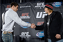 NEW YORK, NY - JANUARY 30:  (L-R) UFC Bantamweight Champion Renan Barao and Urijah Faber shake hands in front of the media during the UFC 169 Ultimate Media Day at The Theater at Madison Square Garden on January 30, 2014 in New York City. (Photo by Jeff Bottari/Zuffa LLC/Zuffa LLC via Getty Images)