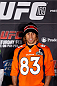 NEW YORK, NY - JANUARY 30:  Urijah Faber poses for photos wearing a Denver Broncos jersey during the UFC 169 Ultimate Media Day at The Theater at Madison Square Garden on January 30, 2014 in New York City. (Photo by Josh Hedges/Zuffa LLC/Zuffa LLC via Getty Images)
