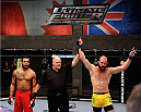LACHUTE, CANADA - NOVEMBER 14:  (R-L) Team Australia fighter Richard Walsh celebrates after defeating Team Canada fighter Matthew Desroches in their welterweight fight during filming of The Ultimate Fighter Nations television series on November 14, 2013 in Lachute, Quebec, Canada. (Photo by Richard Wolowicz/Zuffa LLC/Zuffa LLC via Getty Images) *** Local Caption *** Richard Walsh; Matthew Desroches