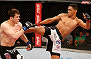 JARAGUA DO SUL, BRAZIL - FEBRUARY 15:  (R-L) Ildemar Alcantara kicks Albert Tumenov in their welterweight fight during the UFC Fight Night event at Arena Jaragua on February 15, 2014 in Jaragua do Sul, Santa Catarina, Brazil. (Photo by Josh Hedges/Zuffa LLC/Zuffa LLC via Getty Images)