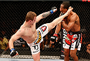 JARAGUA DO SUL, BRAZIL - FEBRUARY 15:  (L-R) Jesse Ronson kicks Francisco Trinaldo in their lightweight fight during the UFC Fight Night event at Arena Jaragua on February 15, 2014 in Jaragua do Sul, Santa Catarina, Brazil. (Photo by Josh Hedges/Zuffa LLC/Zuffa LLC via Getty Images)