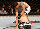 JARAGUA DO SUL, BRAZIL - FEBRUARY 15:  (R-L) Erick Silva punches Takenori Sato in their welterweight fight during the UFC Fight Night event at Arena Jaragua on February 15, 2014 in Jaragua do Sul, Santa Catarina, Brazil. (Photo by Josh Hedges/Zuffa LLC/Zuffa LLC via Getty Images)