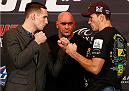 LAS VEGAS, NV - FEBRUARY 20:  (L-R) Opponents Rory MacDonald and Demian Maia face off during the final UFC 170 pre-fight press conference at the Mandalay Bay Resort and Casino on February 20, 2014 in Las Vegas, Nevada. (Photo by Josh Hedges/Zuffa LLC/Zuffa LLC via Getty Images)