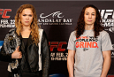 LAS VEGAS, NV - FEBRUARY 20:  (L-R) Opponents Ronda Rousey and Sara McMann pose for photos during the final UFC 170 pre-fight press conference at the Mandalay Bay Resort and Casino on February 20, 2014 in Las Vegas, Nevada. (Photo by Josh Hedges/Zuffa LLC/Zuffa LLC via Getty Images)