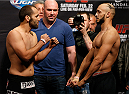 LAS VEGAS, NV - FEBRUARY 21:  (L-R) Opponents Ernest Chavez and Yosdenis Cedeno face off during the UFC 170 weigh-in event at the Mandalay Bay Events Center on February 21, 2014 in Las Vegas, Nevada. (Photo by Josh Hedges/Zuffa LLC/Zuffa LLC via Getty Images)
