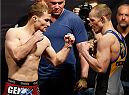 LAS VEGAS, NV - FEBRUARY 21:  (L-R) Opponents Zach Makovsky and Josh Sampo face off during the UFC 170 weigh-in event at the Mandalay Bay Events Center on February 21, 2014 in Las Vegas, Nevada. (Photo by Josh Hedges/Zuffa LLC/Zuffa LLC via Getty Images)